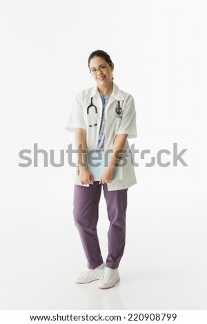 Studio shot of Hispanic female doctor - stock photo
