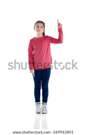 Studio shot of innocent little young girl pointing up at copyspace on white background - stock photo