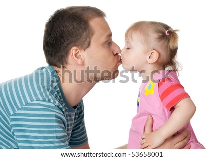 studio shot of little girl and her dad giving kiss - stock photo