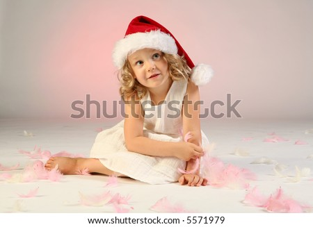Studio shot of little girl as a Santa Claus.