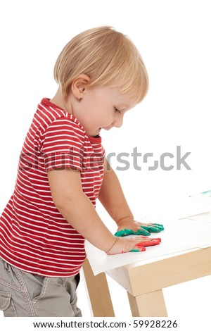 studio shot of little girl drawing with her hands