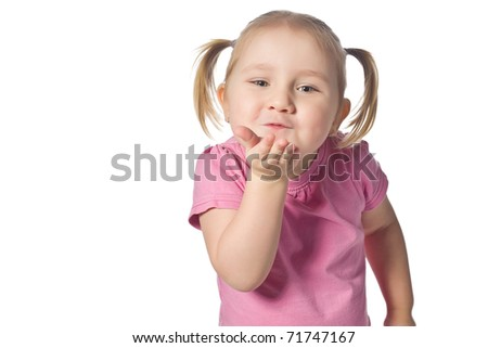 studio shot of little girl sends kiss - stock photo
