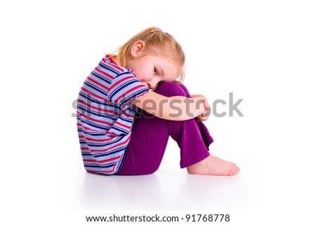 studio shot of little girl with sad expression - stock photo