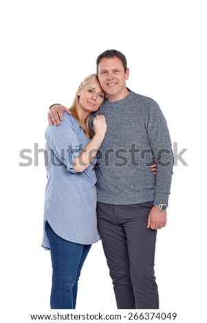 Studio shot of loving mature couple standing together on white background - stock photo