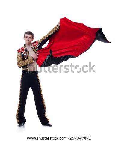 Studio shot of man dressed as bullfighter - stock photo