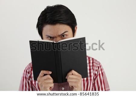 studio shot of Man holding open book - stock photo