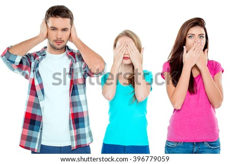 Studio shot of nice young friends. Beautiful people with eyes, ears, mouth closed looking like three monkeys. Isolated background - stock photo