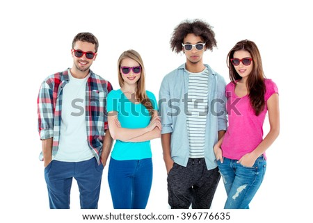 Studio shot of nice young multicultural friends. Beautiful people looking at camera, wearing sunglasses and smiling. Isolated background - stock photo