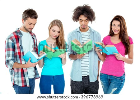Studio shot of nice young multicultural friends. Beautiful people reading books. One girl looking at camera and smiling. Isolated background - stock photo