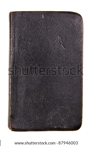 Studio shot of old black book on white background - stock photo