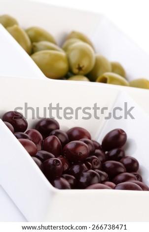Studio shot of olives in bowl - stock photo