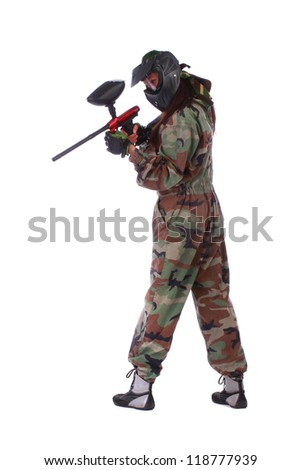 Studio shot of paintball player isolated in white background - stock photo