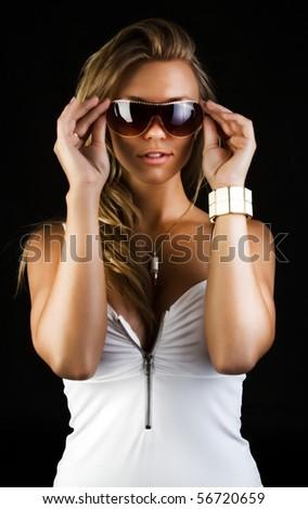 Studio shot of posing woman - stock photo