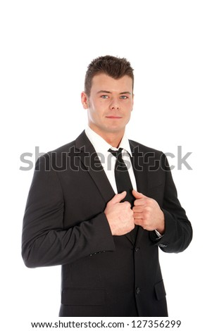 Studio shot of positive young businessman isolated on white