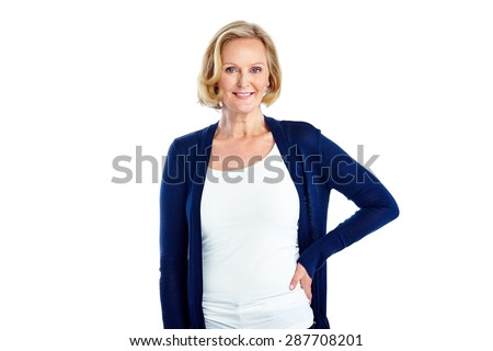 Studio shot of pretty mature woman posing with her hand on hip against white background - stock photo
