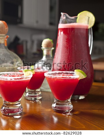 studio shot of raspberry or cranberry margaritas and pitcher - stock photo