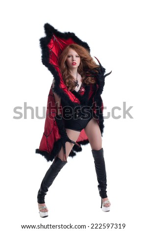 Studio shot of red-haired woman dressed as devil - stock photo