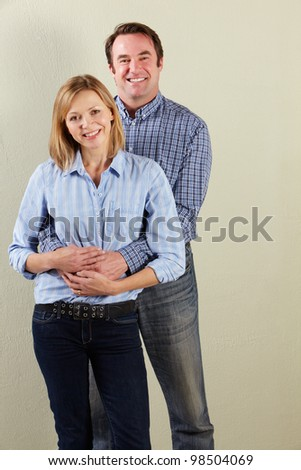 Studio Shot Of Relaxed Middle Aged Couple - stock photo
