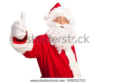 Studio shot of Santa Claus giving a thumb up and looking at the camera isolated on white background - stock photo