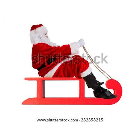 Studio shot of Santa Claus on sledge, isolated on white background - stock photo
