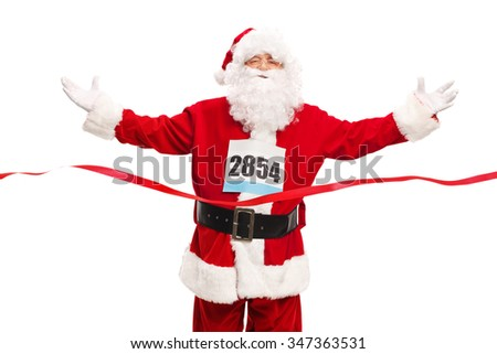 Studio shot of Santa Claus wearing a race number on his chest and crossing the finish line isolated on white background - stock photo