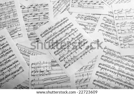 Studio shot of scattered music sheets. - stock photo