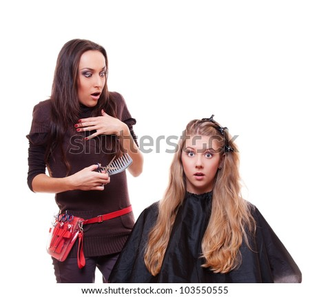 studio shot of shocked hairdresser and client isolated on white background - stock photo