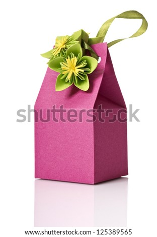 Studio shot of small gift box with decoration. Box isolated on white background. - stock photo