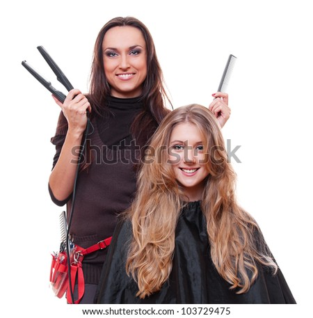 studio shot of smiley hairdresser with straighteners over white background - stock photo