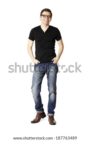 Studio shot of smiling man in black t-shirt and blue jeans.