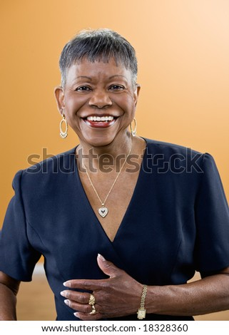Studio shot of smiling mature African woman with short hair - stock photo