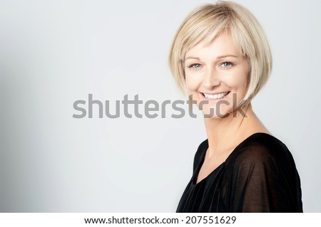 Studio shot of smiling middle-aged woman