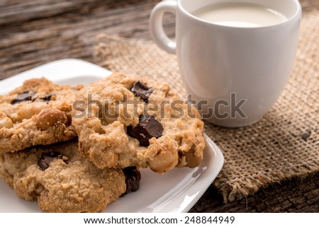 Studio Shot of Stack of Chocolate chip cookie and glass of milk - stock photo