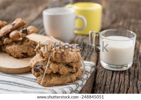 Studio Shot of Stack of Chocolate chip cookies and glass of milk - stock photo
