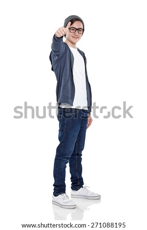 Studio shot of stylish teenage boy giving you a thumbs up over white background - stock photo