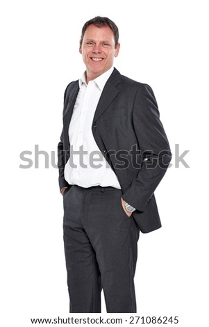Studio shot of successful mature businessman standing with his hands in pocket over white background - stock photo