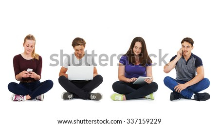 Studio Shot Of Teenagers Using Communication Technology - stock photo