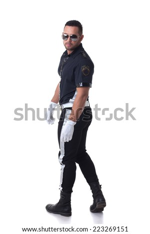 Studio shot of trendy serious policeman - stock photo
