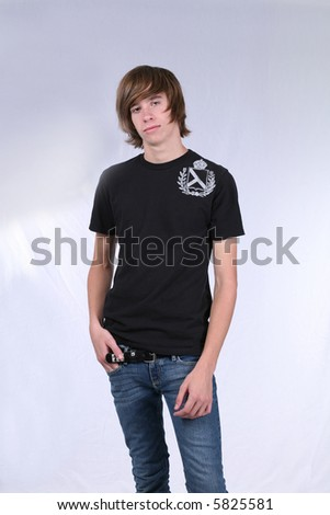 Studio shot of trendy teen boy