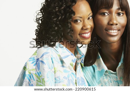 Studio shot of two African women smiling - stock photo