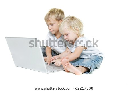 studio shot of two kids with laptop