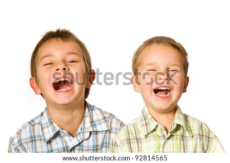 studio shot of two laughing boys - stock photo