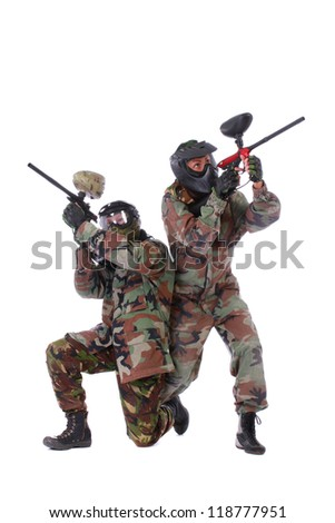 Studio shot of two paintball players isolated in white background - stock photo