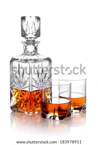 Studio shot of whisky in a carafe and two glasses isolated on white - stock photo