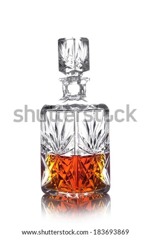 Studio shot of whisky in carafe isolated on white