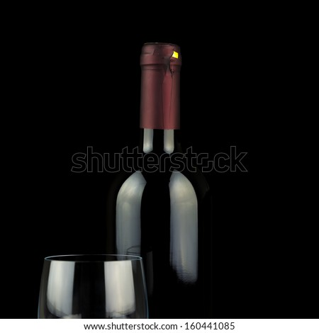 Studio shot of wine glass and a bottle isolated over black background.