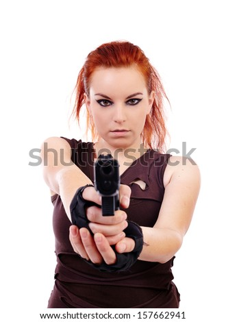 Studio shot of woman holding a gun and aiming  isolated over white background - stock photo