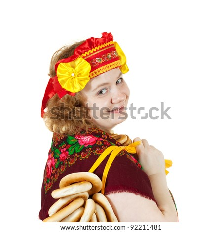 Studio shot of woman in Russian traditional clothes. Isolated over white background