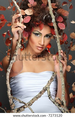 studio shot of woman representing autumn