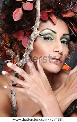 studio shot of woman representing autumn - stock photo